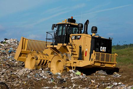 CAT Compactor in a landfill
